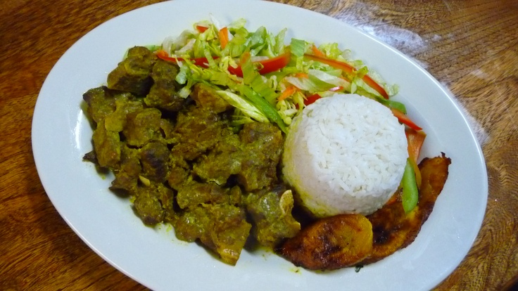 curry goat with white rice fried plantains and steamed