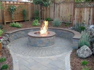 #FashionYourHome   LOVE  IT!  stone veneer patio fire pit - Chamber of commerce idea - change fire pit to fountain/fish pond/large planter?