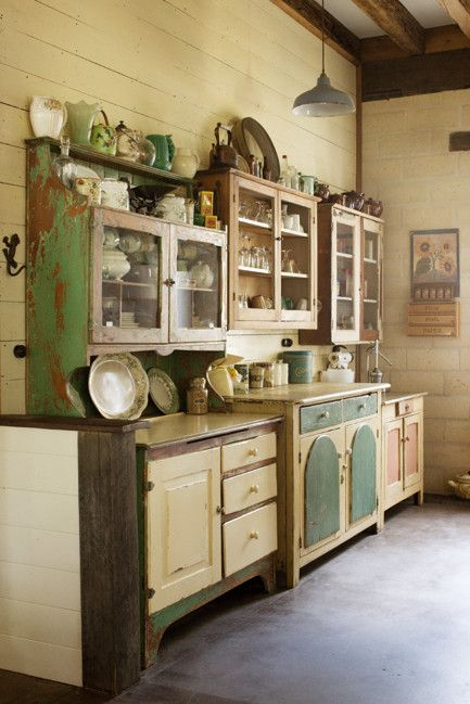 A collection old cabinets serve as cupboard storage in a country kitchen!