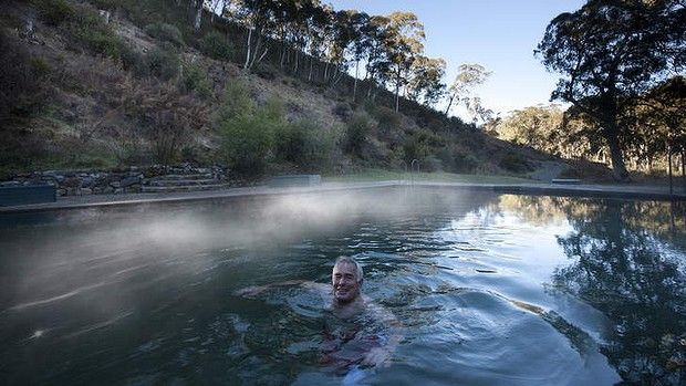 Mist rises off Yarrangobilly's thermal pool at dawn. Caves and thermal pool near Canberra.