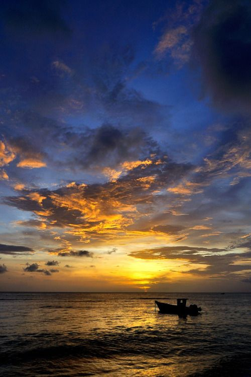 Boat and Sunset in Tobago Island -  located northeast of the mainland of Trinidad and southeast of Grenada.