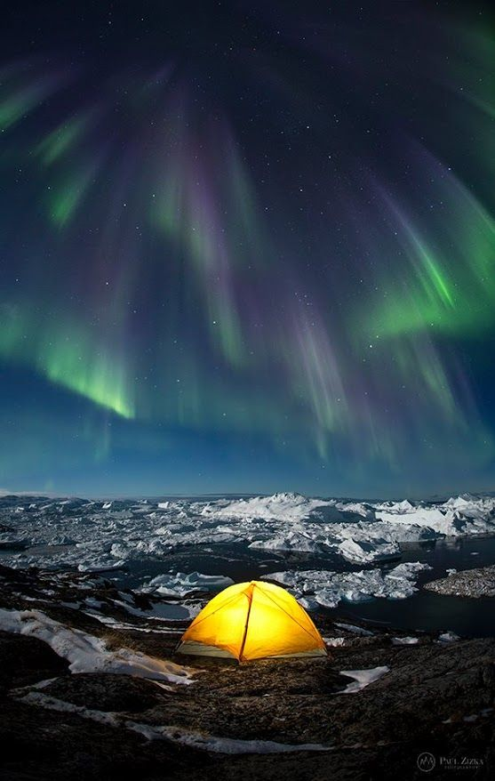 """#ArcticDream Paul: """"Another crazy night in Greenland, as the aurora pours down onto the ice giants below."""" 