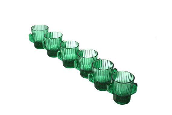 Beautiful collectible green cactus shot glasses. This is a set of 6 Libbey green cactus shot glasses. If your looking to buy just one shot glass or a couple you can purchase individual cactus shot glasses here: http://etsy.me/2eJPnRZ  You can view our complete line of Vintage Cactus Glassware here: http://etsy.me/2dIZ3rD  D E T A I L S:  *Measures: 2.5 Tall X 2 Wide  * Condition: Great vintage condition with no chips  Visit our other Home Décor Sections:  Vintage Home Décor…