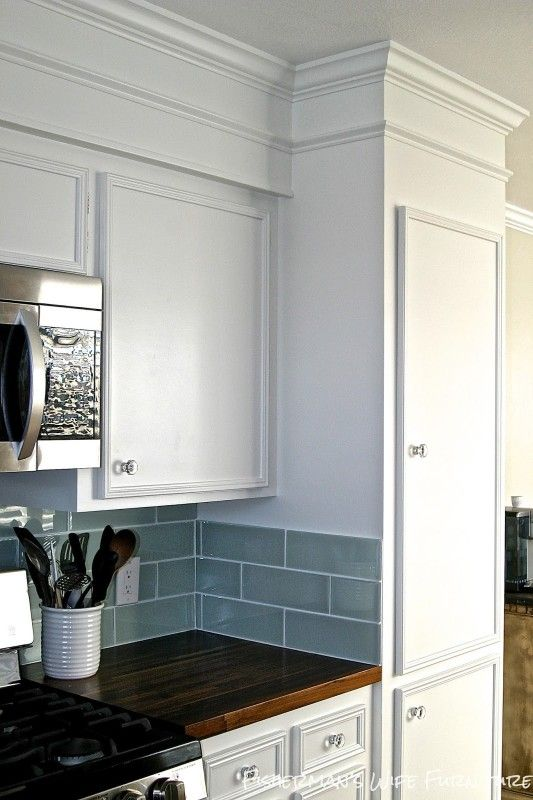 Small White Kitchen Makeover with Built-In Fridge Enclosure