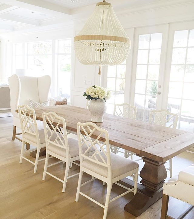 Warm white wood table beaded chandelier diningchairs