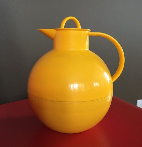 this is a great bright yellow plastic and glass insulated carafe by Alfi. it was designed by Ole Palsby in Denmark and made in Western Germany. spherical with a screw top lid, this piece is in excellent condition. there are no cracks or scratches. what a wonderful piece for your breakfast table or for afternoon tea.  measurements are approx. 8 tall 7 wide  please contact me for accurate international shipping costs.  please see more kitchen, bath and linens here! http://www.etsy.com...