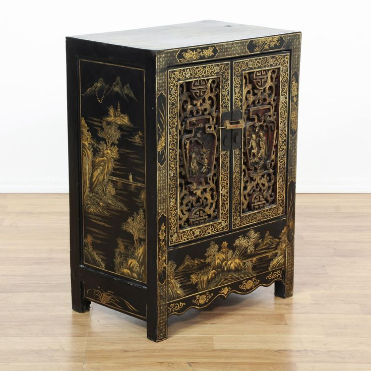 This Chinese cabinet is featured in a solid wood with a glossy black lacquered finish. This small server bar has 2 intricate carved panel doors, a large interior cabinet and ornate gold painted chinoiserie scenes. Stunning storage piece perfect as a small buffet console!  #asian #tables #endtable #sandiegovintage #vintagefurniture