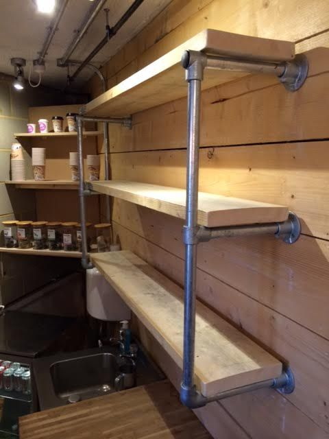 A key clamp shelf for a coffee bar in london. Very unique use of Key Clamp & Scaffold Board.
