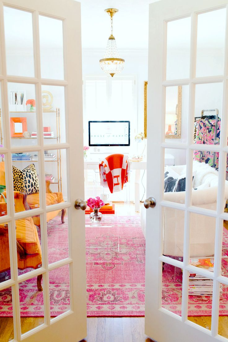 French doors to home office with bright colors and red Hermès blanket over office chair