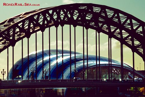 The Sage, through Tyne Bridge. Newcastle, United Kingdom. Travel to Newcastle in just 3 hours by train or stay overnight before catching the ferry to Amsterdam with DFDS.