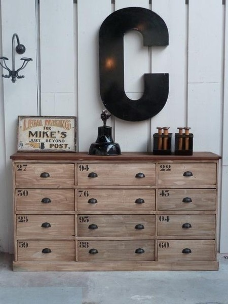 I love this paint technique on the dresser..and the initial and the sign