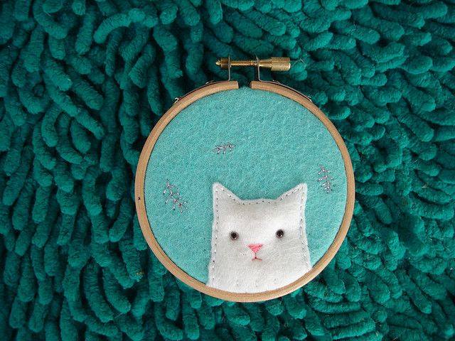 kitty on embroidery loop.... orange kitty on green background or gray kitty on ? background... what would look good?