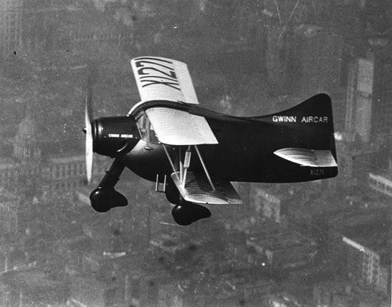 Gwinn Aircar. The Gwinn Aircar was a single-engined biplane with a cabin for two, designed in the USA as a safe and simple private aircraft. Lacking a rudder, it had several unusual control features as well as an early tricycle undercarriage. Development was abandoned after a crash in 1938.