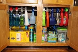 Use a tension shower curtain rod (only $8!) under the sink for hanging bottles of cleaner. This blog has other great kitchen organizing tips! by marylou