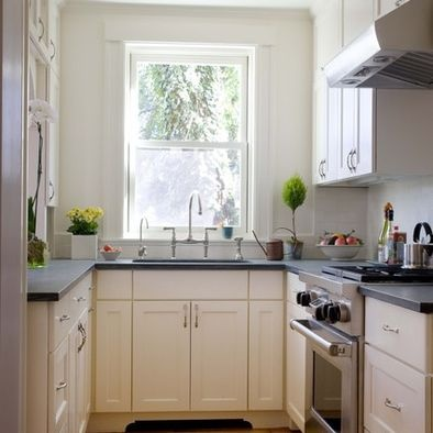 U Shaped Small Kitchen With Soapstone White Cabinetry
