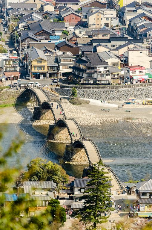 Kintai Bridge, one of the oldest in Japan, seen from the top of the Iwakuni Castle. Iwakuni, Yamaguchi Prefecture, Japan.