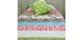 This stunning and colourful Abby coverlet will be a great addition to any girl's bedroom.