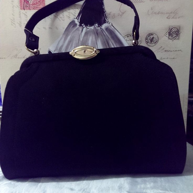 Vintage Early 1960\'s Black Suede Wide Handbag on Velvet Rose's Pin Up Dressing Room  A beautiful vintage early 1960's Black Suede Handbag, lining is caramel colour suede. It is in great condition - it is deadstock and comes from a handbag manufacturer's warehouse. The measurements of the bag are width 28.5cm height 24.5 cm and depth 13.5cm. There is an original old stock tag still attached see photo. Also there is original newspaper still in the bag from August 1965 (see photo).