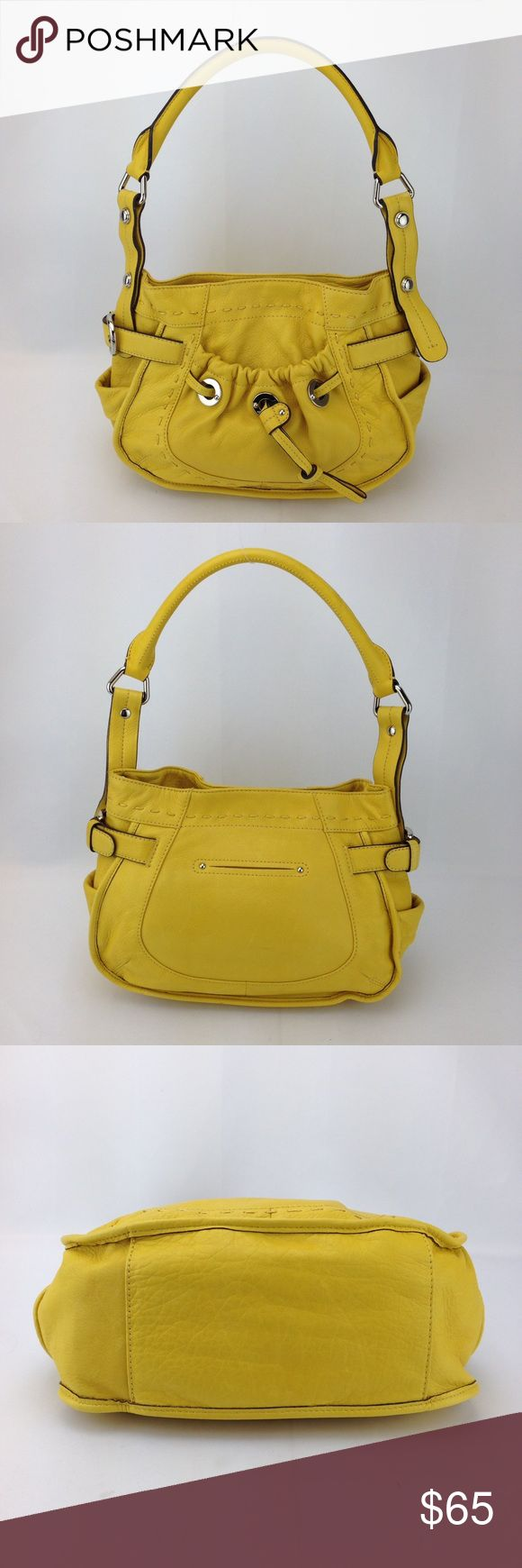 "B. Makowsky Yellow Pebble Leather Shoulder Bag B. Makowsky Yellow Pebbled Leather Shoulder Bag in great condition! 100% authentic.   Exterior features: - yellow pebble leather with tonal stitching - front elastic pocket with drawstring embellishment beneath - belted embellishment on sides - flat slit open pockets on sides - single rolled shoulder strap with 8"" drop - magnetic closure on top  Interior features: - dark leopard polyester lining - zippered pocket on one wall with leather trim…"