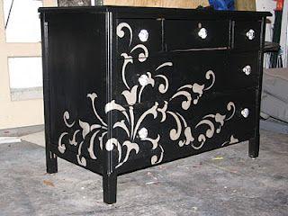 Black dresser with champagne vines