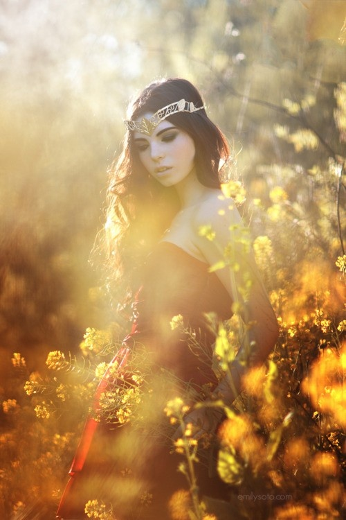 Briah as a young maiden gathering flowers from the meadow. She wears a crown, though orphaned, knowing by blood that she is a princess.