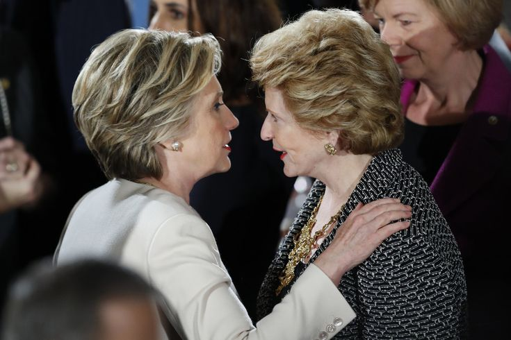Hillary Clinton Photos Photos - Hillary Clinton greets Sen. Debbie Stabenow (D-MI) during the Inaugural Luncheon in the US Capitol January 20, 2017 in Washington, DC. President Donald Trump is attending the luncheon along with other dignitaries after being sworn in as the 45th President of the United States. - President Donald Trump Attends Inaugural Luncheon
