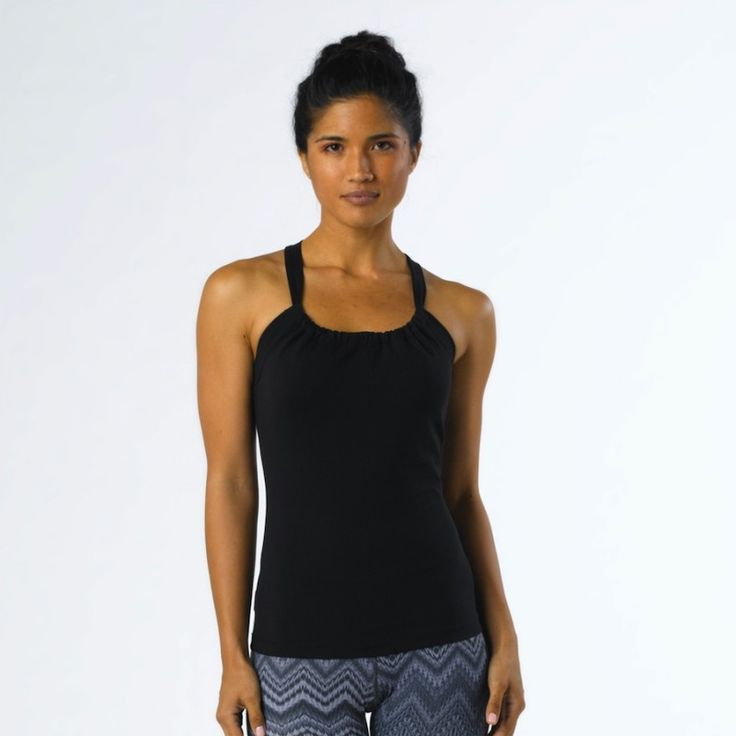 Quinn Chakara Top Black. Ladies fitted yoga top is quick-drying, abrasion resistant, and offers hold me in support that fletter any waistline. This funky womans yoga top features a scoop neck design with unique double strap racerback and internal shelf bra. This is a yoga top, running top, pilates top an all over great ladies work out top. - See more at: https://yogagps.com/shop/yoga-clothes/quinn-chakara-top.html#/size-xs/colour-dragonfly