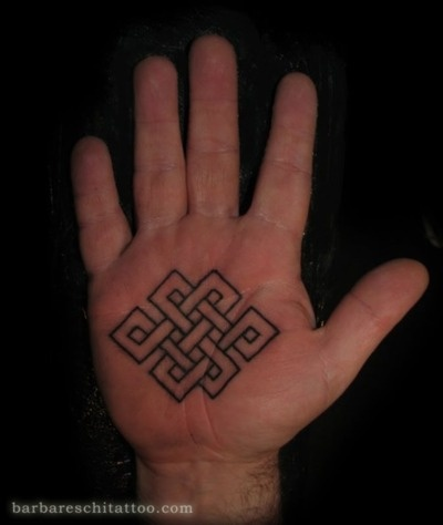 tattoo - Buddhist endless knot (not into the placement, but I love the shape and overall meaning)