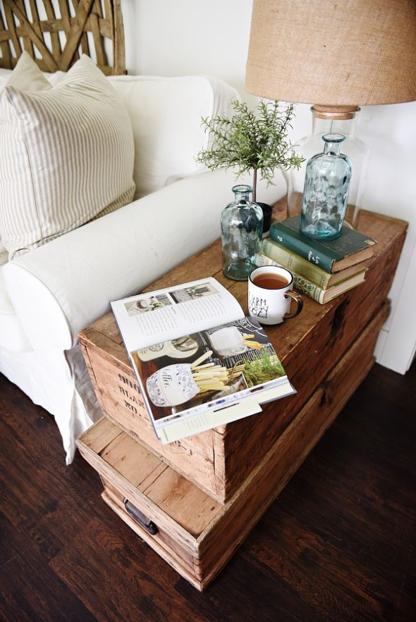 Lovely neutral cottage style living room - stacked trunk end table. Cozy rustic farmhouse style.