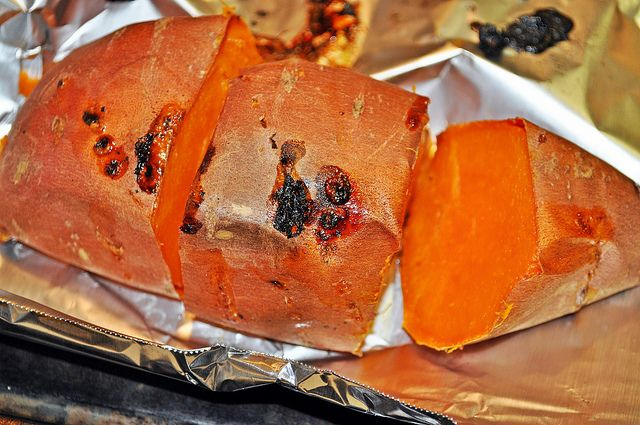 The perfect baked sweet potato - wash, dry, poke holes, bake at 450 for 30 min, turn over, bake another 30 min, let cool & cut into serving portions so you can eat them all week.