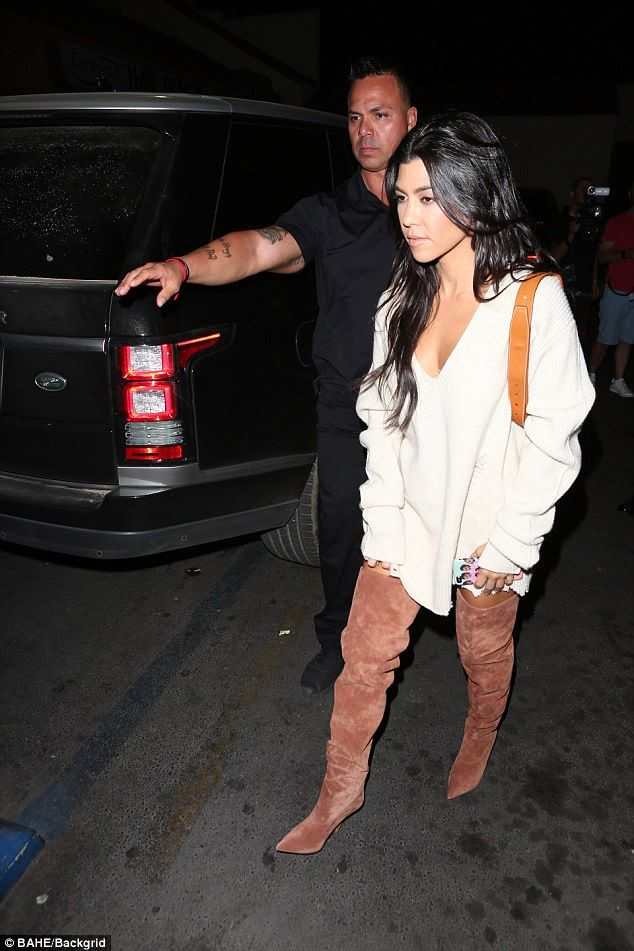 Walk it out: The eldest of the Kardashian daughters carried a large brown bag on her shoul...