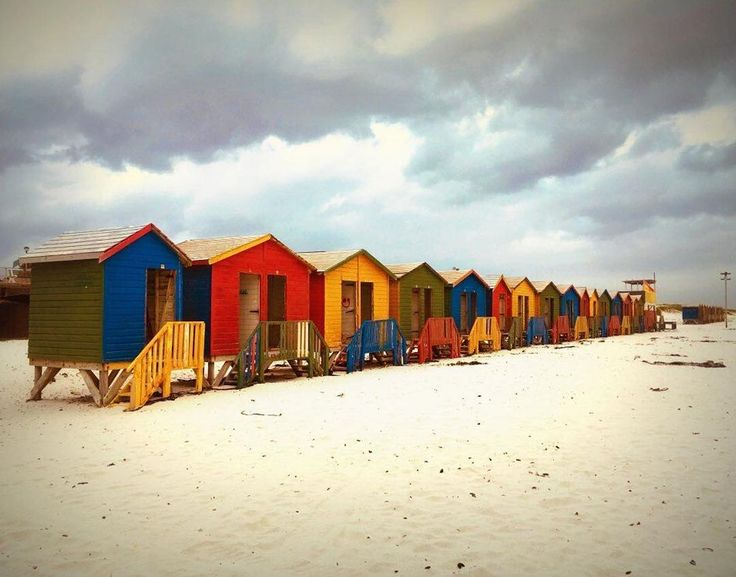 If the sky isnt always blue in Cape Town the Muizenberg beach huts guarantee a colourful sight for tourists having an afternoon walk as well as for local surfers coming back from a ride. _____________________ Photo: @chagallaure  #Muizenberg #beachhuts #clouds #sand #CapeTown #SouthAfrica #citylife #ilovecapetown #beach