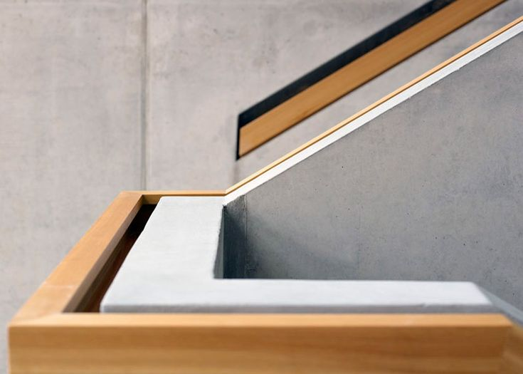 Stair detail - Swiss school extension by Zwimpfer and BBK fronted by larch battens