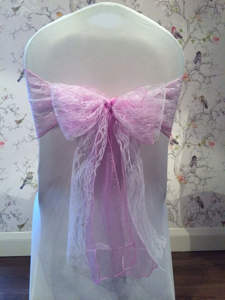 One of our beautiful chair cover designs. Lilac organza sash with a lace overlay.  Contact us for more design ideas  www.lakelandevents.co.uk