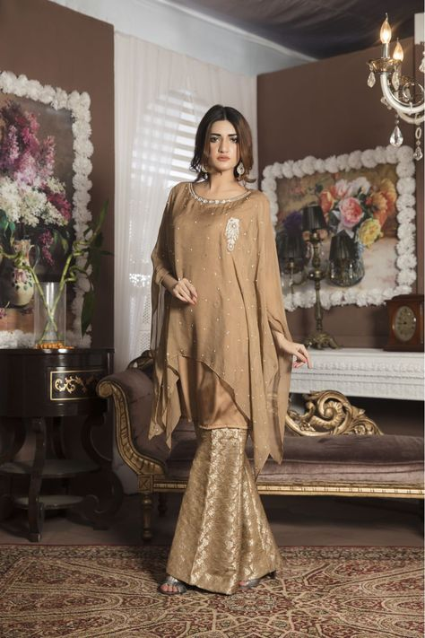 looking for a casual dress then this beautiful light brown dress should fill your requirement. This beautiful two piece dress is comprised of these fabrics. On shirt we are using viscose fabric and shamooz fabric for inner. For bottoms we are using jamawar fabric. We are offering make to measure designs.  HAND EMBRIODERY PATTERN (2 PIECE)  UPPER:CHIFFON GEORGETTE INNER:PRINTED SHAMOOZ PEPLUM PANTS: QURESHIA NET AND COTTON  Product ...