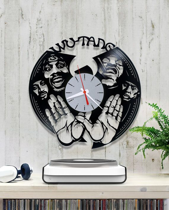 Hi Everyone! For sale is a clock made from an old vinyl record. I have many other designs, please check my listings.  Measures: 30 cm or 12 inches in diameter. Runs on one AA battery (not included) in quality made mechanism. I have fitted it with bi-color (black/white) clock hands. The clock movement has a hook on the back for easy hanging.  I have found that vinyl clock could be a great gift. That is why I have made some drawings with popular characters. You are also welcome to contact ...