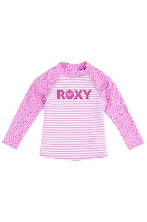 Roxy Coney Island Long Sleeve Rash Vest - Roxy Coney Island Long Sleeve Rash Vest with;  Cute contrast spot and stripe print Long sleeves high neck style for extra protection against the sun Roxy word chest rubber print UV tech print Made from Matte 80% Nylon, 20% Elastane fabric  Contrast spot and stripe long sleeved rashie featuring high neck styling, UV Tech 40+ sun protection, and Roxy word logo rubber print on chest.