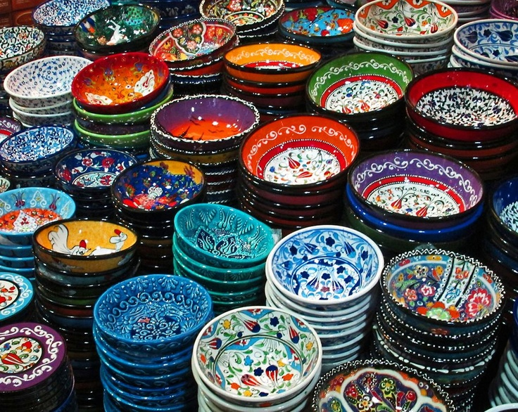 """The Grand Bazaar (Turkish: Kapalıçarşı, meaning """"Covered Bazaar""""; also: Turkish: Büyük Çarşı, meaning """"Grand Bazaar"""") in Istanbul is one of the largest and oldest covered markets in the world, with 61 covered streets and over 3,000 shops which attract between 250,000 and 400,000 visitors daily."""