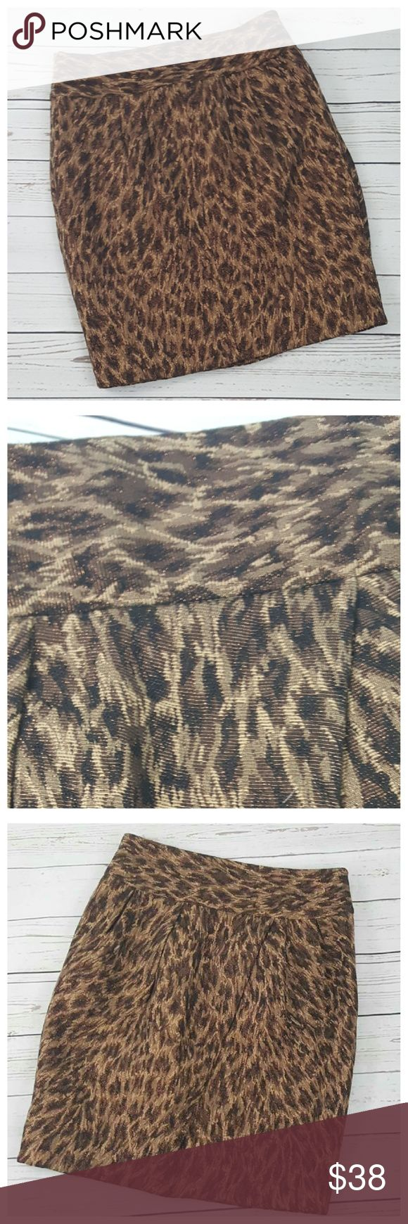 "Adrienne Vittadini Metallic Animal Print Skirt sz6 Adrienne Vittadini animal print metallic finish skirt in shades of brown, tan & copper colored metallic threads. Size 6. Fully lined. Hidden 8"" side zipper with hook & eye at top. Wide 3.5"" waistband. Four small front pleats and faux wrap effect in the front. 49% polyester, 48% cotton, 2% nylon, and 1% metallic threads. New with tags.  Approximate measurements laying flat: 15""W (30"" around), 20""H (40"" around), 21""L. Adrienne Vittadini Skirts…"