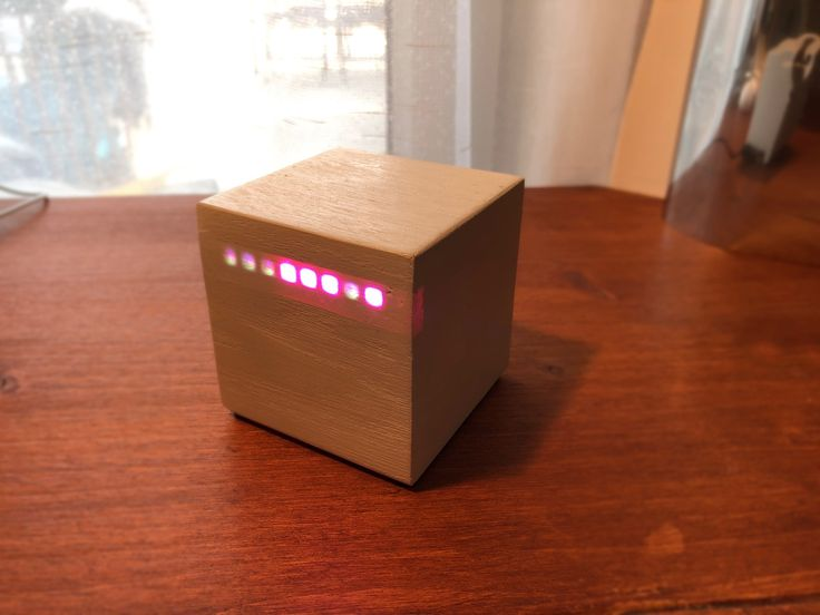Minimalist binary clock with solid wood cube. Shows the exact time (alternating hours and minutes) and the days of the week with seven different colors.  https://youtu.be/hgYvGP2q2ro