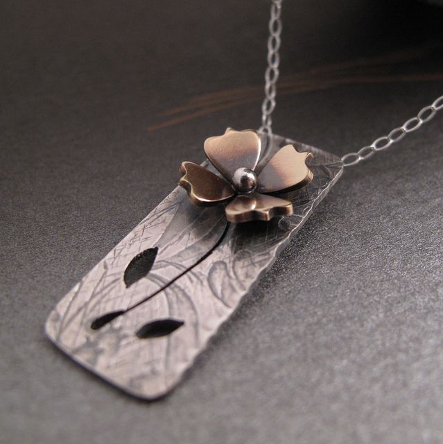 Jewelry   Jewellery   ジュエリー   Bijoux   Gioielli   Joyas   Art   Arte   Création Artistique   Artisan   Precious Metals   Jewels   Settings   Textures   Flower Pendant  by Laura Flavin.  Sterling silver