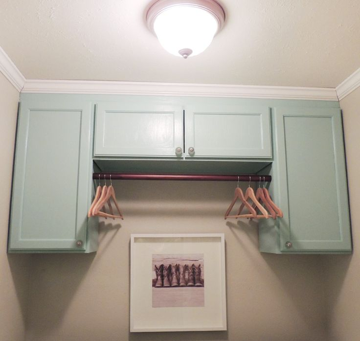 Paint your laundry room cabinets a bright color like teal to brighten up the room