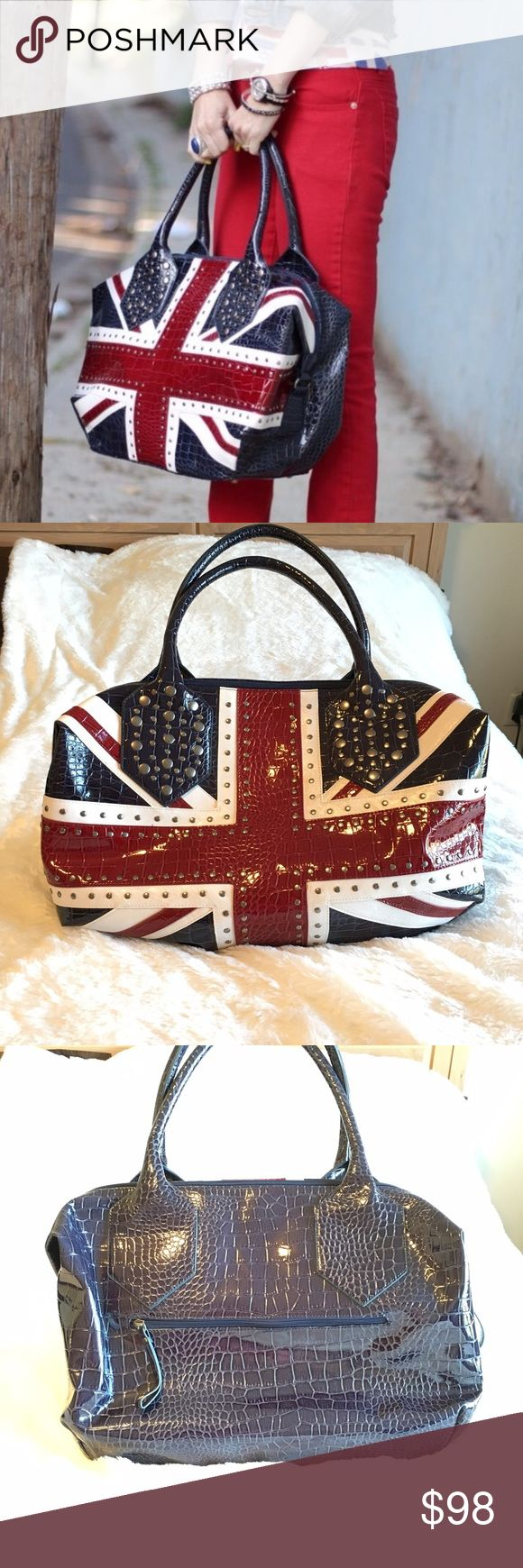 """🆕Twiggy London Union Jack Studded Weekender Bag Absolutely amazing bag!! Twiggy London Union Jack studded weekender bag. In like new condition. Super roomy with interior zipper pocket. Gorgeous studs. An eye-catcher for sure! Measures 20""""x14""""x7.5"""". ❌NO TRADES❌NO LOWBALLING❌ **borrowed this first pic with permission, all the rest are mine. Twiggy London Bags Travel Bags"""