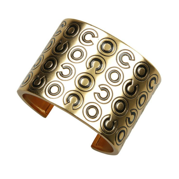 Wide COCO CHANEL Cuff Bracelet | From a unique collection of vintage cuff bracelets at http://www.1stdibs.com/jewelry/bracelets/cuff-bracelets/