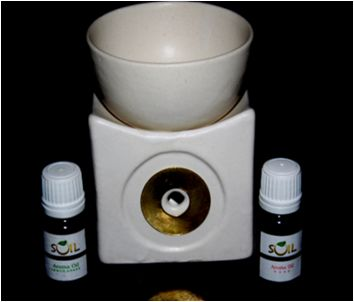 Square shape Lamp  Burner Aroma Lamps : Aroma diffuser lamp rejuvenates the atmosphere of your house or office and is believed to bring calm energy to it, thus helping to create a sense of balance & harmony. Just light the tealight candle in the hollow space at the back of the lamp & pour the aroma oil mixed with water on the top and feel the fragrance around you.