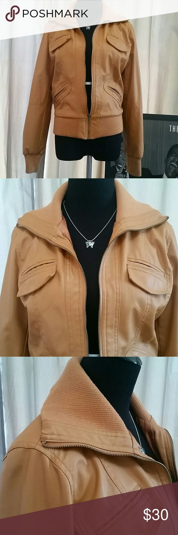 Lovely Camel Leather Jacket. Size L Beautifully constructed Vegan Leather Jacket in a lovely Camel / Caramel / Tan / Light Brown Color.  Two bottom pockets in front are real!   Sexy cheetah print inner lining in near perfect condition, just some worn threading in the very center.   Bundle & save! 20% off 3+ items. No offers ever declined! Closet Jackets & Coats