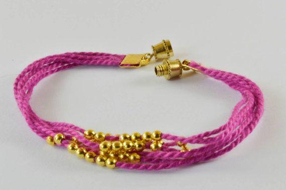 $12 pink and gold Bracelet
