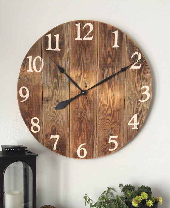 large wooden wall clock made from pine boards wood comes from barn siding that is
