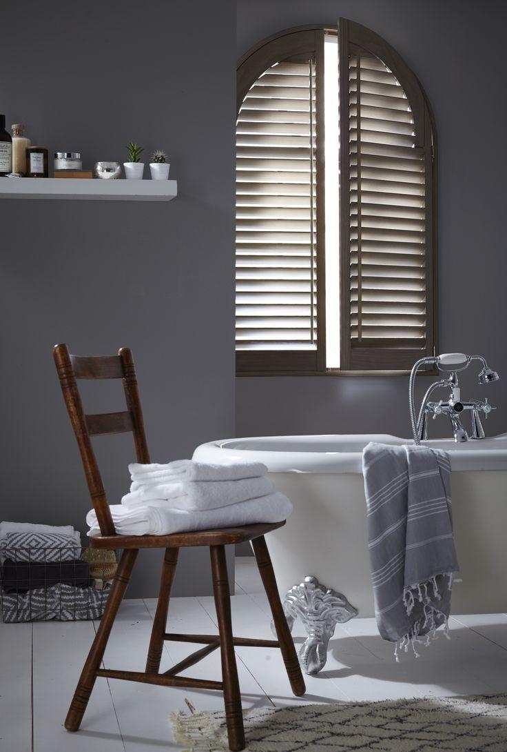 Arched Wooden Bathroom Shutters. Unusual shaped shutters inspiration. Bathroom shutters. Contemporary bathroom home decor ideas.