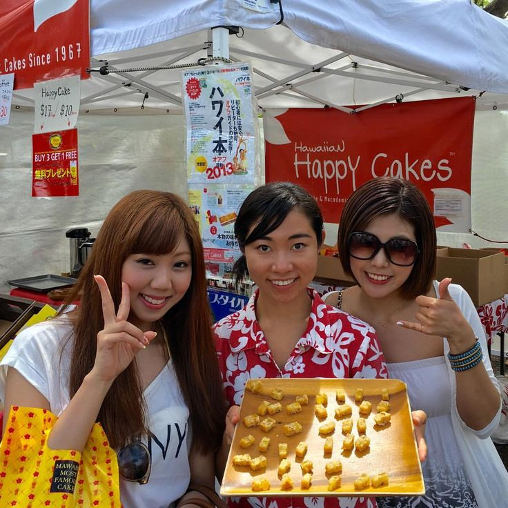 Three big smiles at the KCC farmers market